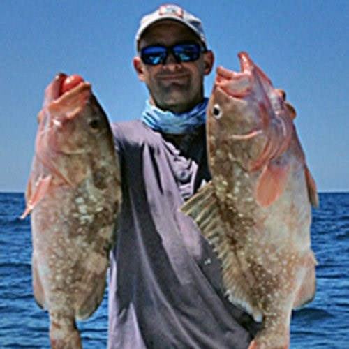 Capt. Craig with Two Big Groupers