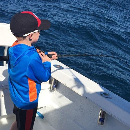 Young Angler Catches Fish